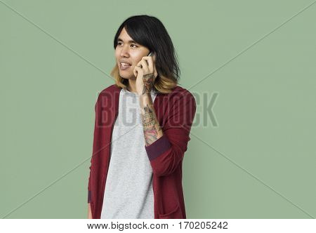 Asian guy talking on the phone portrait