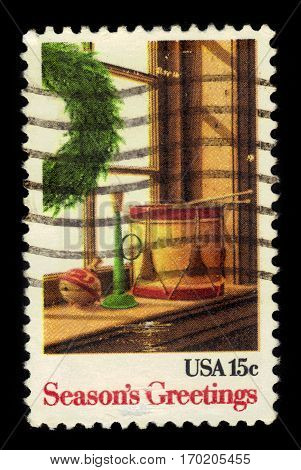 UNITED STATES - CIRCA 1980: A stamp printed in USA shows wreath and toys, season's greetings, circa 1980