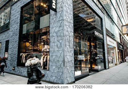 New York, February 6, 2017: People walk by a Diesel store in Manhattan.
