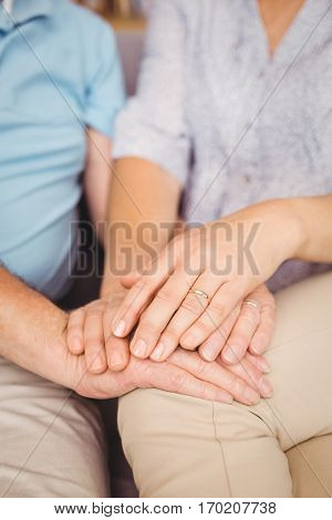 Close-up of couple holding hands while comferting eachother