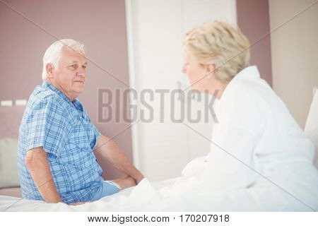 Angry senior couple in bedroom at home