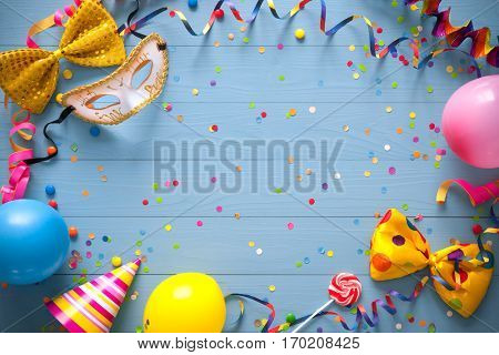 Colorful birthday frame with party items on blue background. Happy birthday concept