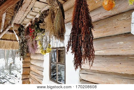 Suspended Bunches Of Dried Herbs At Porch Of An Old Wooden Cottage