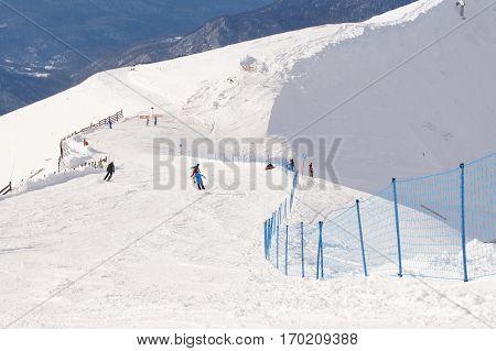 Sochi, Russia - 1 January, People skiing descend, 1 January, 2017. Winter mountain ski resort Rosa Khutor.