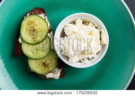Single sandwich with cream cheese and cucumber