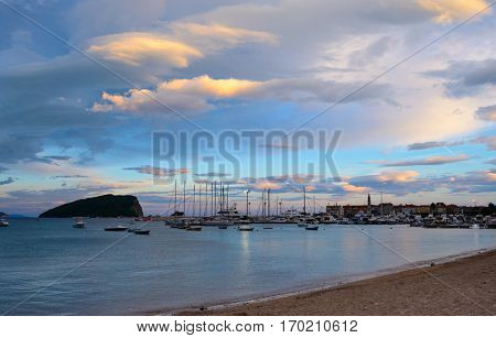 Panoramic View of Old Budva Town, Famous Island of Sveti Nikola and the Dock with Lot of Boats in Budva. Montenegro, Balkans, Adriatic sea, Europe.