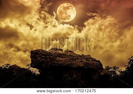 Boulders Against Sky With Clouds And Beautiful Full Moon At Night. Outdoors.