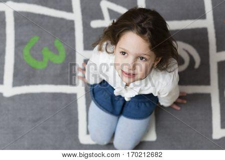 Six years preschool girl looking forward for school