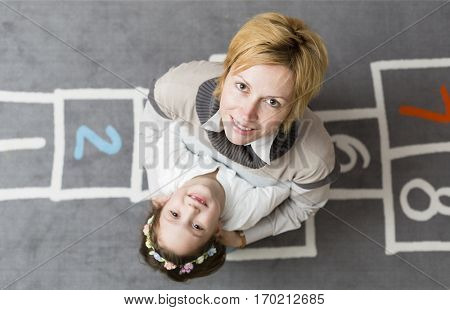Mother supporting daughter about school beginning
