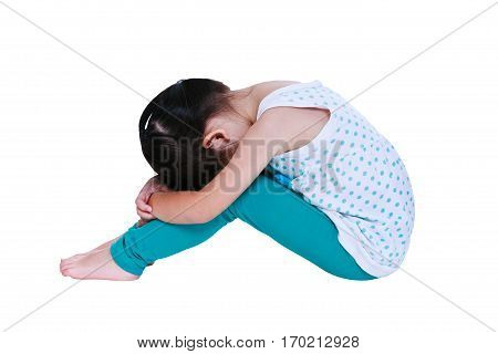 Sadness asian child barefoot sitting on floor. Isolated on white background. Negative human emotions. Conceptual about children who lack warmth and affection abandoned children.