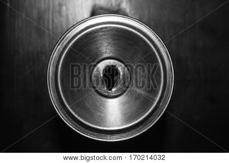 Lock of a black door focused closely.