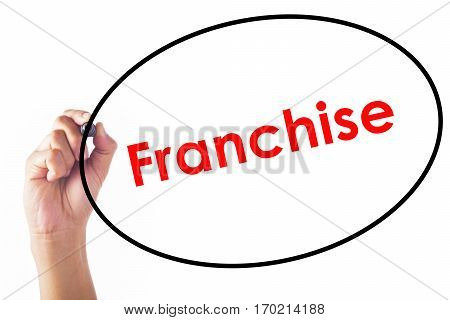 Businessman hand writing Franchise word with pen