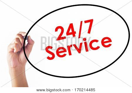 Businessman Writing 24/7 Service Word With Pen