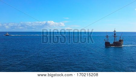 Sailboat in the ocean near the shore with breakwater. Atlantic Ocean Madeira Portugal