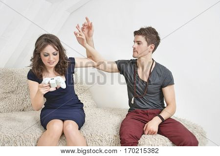Irritated young man with woman playing video game