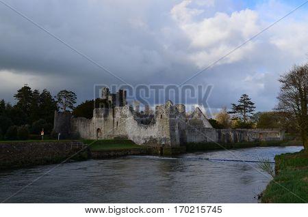 Ireland's Desmond Castle with dark clouds looming over head.