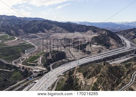 Aerial view of Golden State 5 Freeway and massive garbage landfill in the Newhall Pass in Los Angeles California.