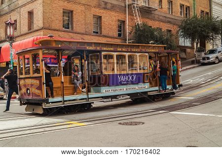 SAN FRANCISCO, Ca, OCTOBER, 09, 2015: Passengers ride in a cable car the most popular attraction of San Fransisco.