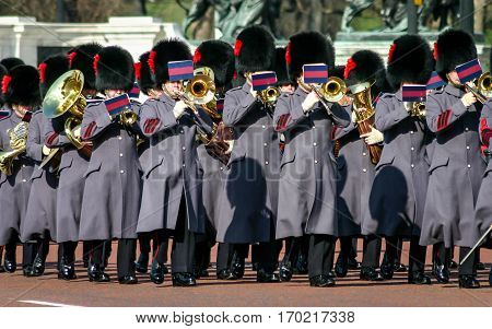 LONDON UK - 3 MARCH 2005: A procession of the band of the Queen's Guard in their traditional beak skin Busby hats with winter overcoats.