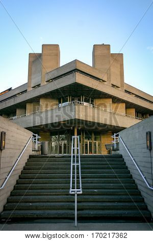 LONDON UK - 3 MARCH 2005: The entrance and facade to the National Theatre. Part of the South Bank complex the building is a classic example of Brutalist architecture.