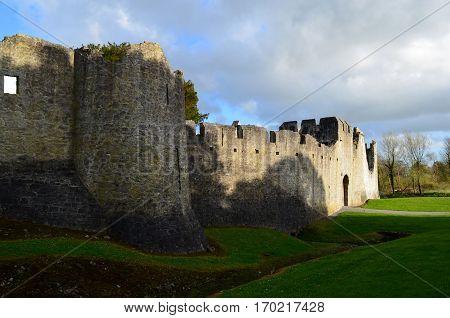 Castle walls surrounding Desmond Castle ruins and grounds