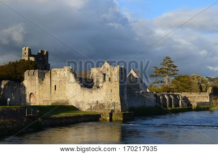 Ruins of Desmond Castle in Adare Ireland by the River Maigue.