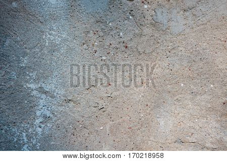 Aged and obsolete gray concrete wall texture closeup