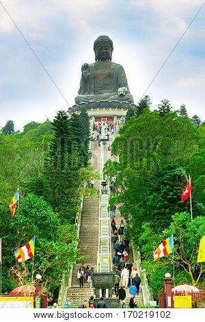 Hong Kong, China - January 9, 2014: Big Buddha, staircase and people going to statue Lantau Island, Hong Kong