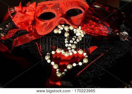 mask women's panties heart on black background heart made of pearl beads