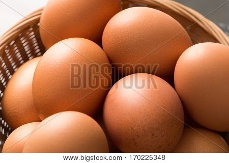 Overhead Close Up Of Brown Hen Eggs In Wicker Tray