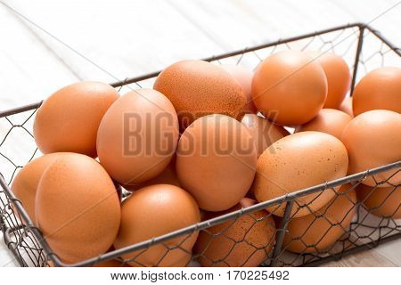 Close Up Of Brown Eggs In Chicken Wire Tray