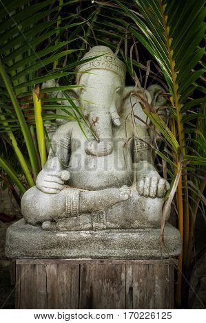 Old concrete  statue of Ganesha - a hindu symbol of luck in the jungle