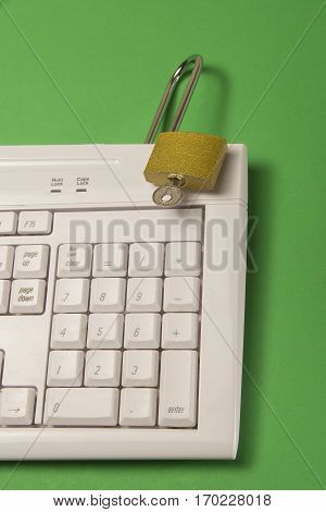 Security with gold metal padlock on a computer
