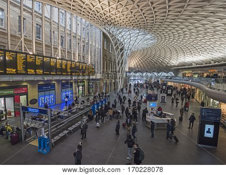 LONDON ENGLAND - JANUARY 26th 2017: London commuters travel through Kings Cross train station on January 26th 2017. London commuters recently said they were unhappy with train travel following industrial action by Southern Rail.