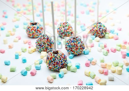 Brownie cake pops with color sugar pearls and marshmallow.
