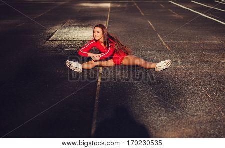 Young female runner doing stretching exercise before began run