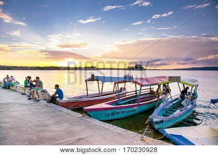 FLORES, GUATEMALA-DEC 20, 2015: Tourist boat at Peten Iitza lake in Flores on Dec 20, 2015. Guatemala.