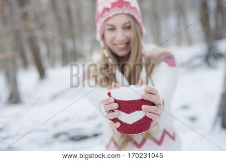 Beautiful Girl Drinking Tea or Coffee outdoor. Woman with a cup of Hot Beverage.