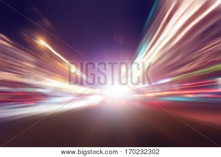 Traffic lights with motion blur on the road at night.