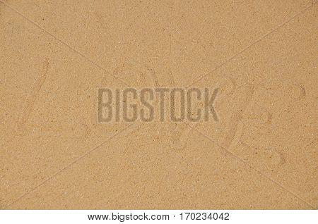 Love message written in sand, Word love on sand