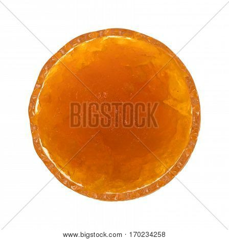 Top view of sugar free apricot preserves in a small glass bowl isolated on a white background.