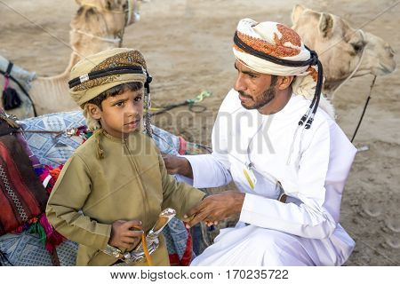 Muscat Oman February 4th 2017: father and son in taditional omani outfits