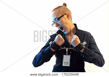 Young beautiful businesswoman screaming with anger prisoner of job in cuffs horizontal view with copy space isolated on white background