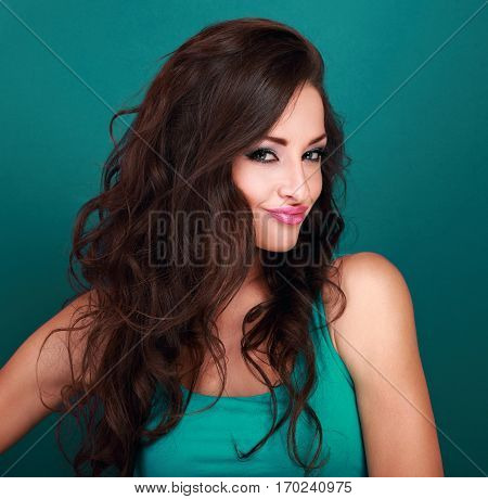 Coquette Grimacing Emotional Makeup Woman With Long Curly Hair Style Looking On Light Green Backgrou