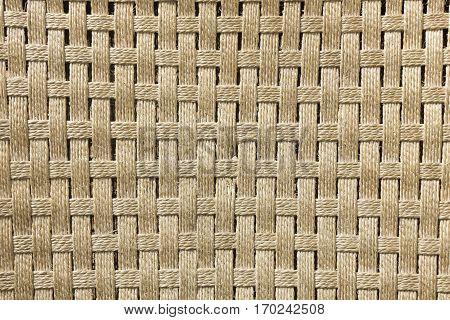 Texture of a handmade brown esparto plait.