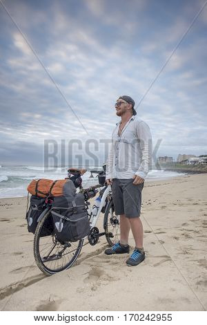 Adventure Cyclist On Beach With Bicycle