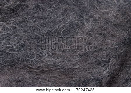 Gray shawl. Texture of woolen shawls. Natural background.