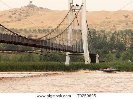 Bridge Over Huang He (yellow River) In Shapotou Scenic Area, Ningxia Province, China