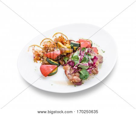 Salad with vegetables and pieces of meat exquisitely decorated. Clipping path