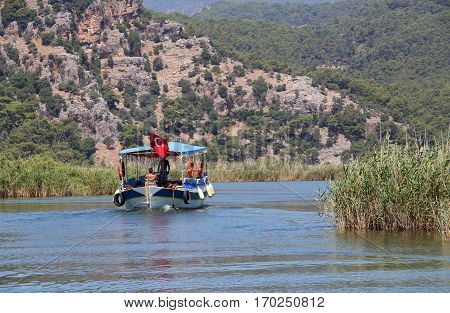 Tourist boat on Dalyan river in protected National Conservation area Dalyan Turkey